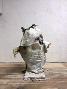 Plaster. Fabric. Burned plastic. / 48 x 27 x 23 cm